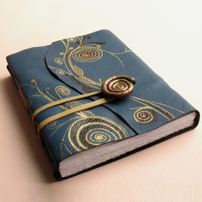 leather and polymer clay journal