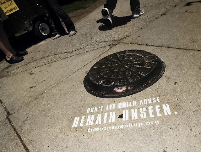 Serve: Manhole cover sticker advertisement