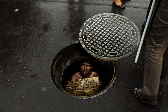 Amnesty international manhole advertisement