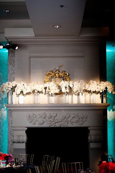 all white phalenopsis orchid arrangements lined the mantle