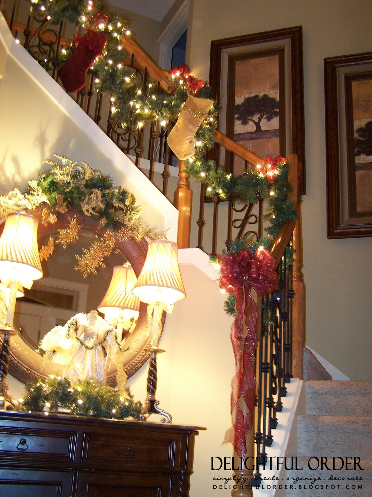Delightful order staircase christmas decorating for Stair railing decorated for christmas