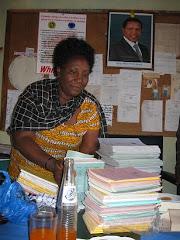 Mwalimu Hellena Buswelu with Donation