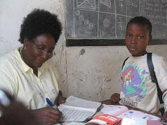 Mwalimu Helena with Buswelu Student