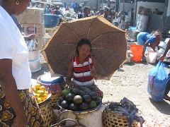 Lady Selling Fruits and Veggies at the Sokoni