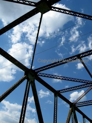abstract photograph metal bridge blue sky