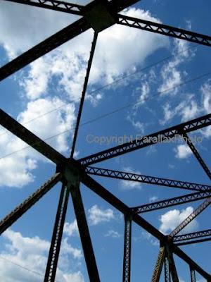 abstract photograph metal bridge blue sky