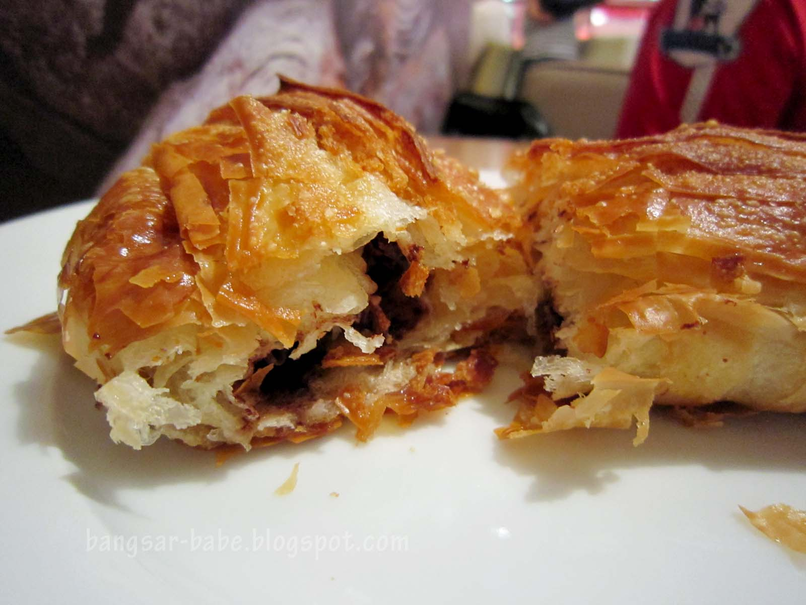 -filled croissant with layers. The pastry was flaky and nicely glazed ...