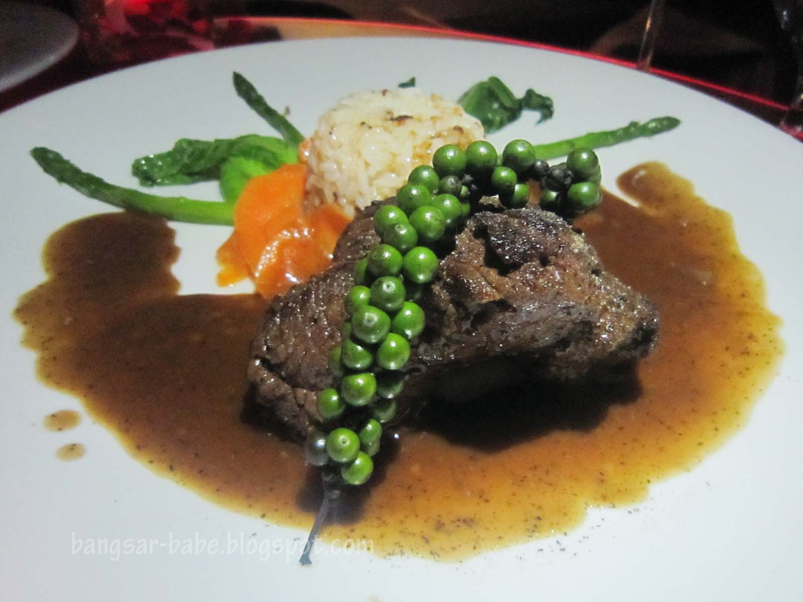 Grilled beef tenderloin with black pepper and peppercorn, with ...