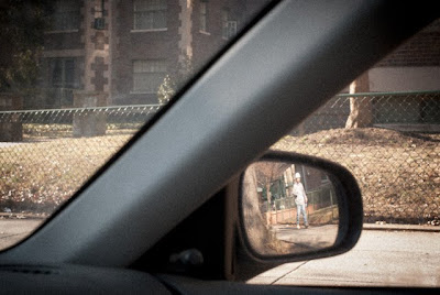 construction worker in car mirror