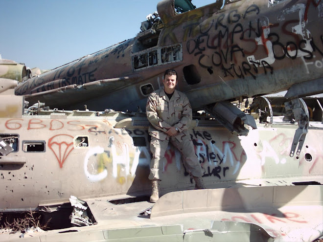 DADIO sitting on destroyed Russian Mig-fighter aircraft