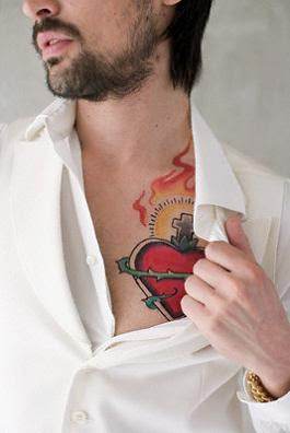 Heart Tattoos With Image A Male Tattoo With Heart Tattoo Designs On The Body Picture 5