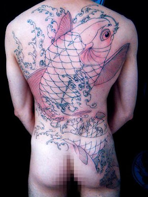 Big transparent koi fish tattoo on a man's back.