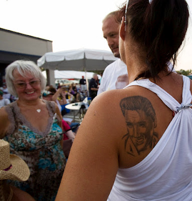 Elvis face tattoo on woman's upper back. Rock Star Tattoo