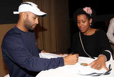 Black Tennis Pro's James Blake speaking with guests at 2010 ABN AMRO World Tennis Tournament