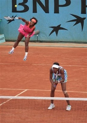 Venus And Serena Take Resumed Doubles Match
