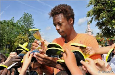 Black Tennis Pro's Gael Monfils signing autographs at Disneyland Paris