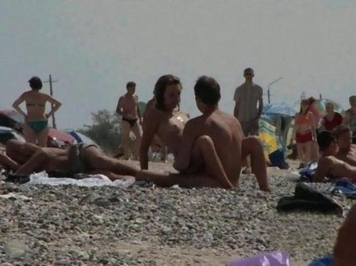 public sex on the beach ... satisfy herself at a public beach in St. Topez in these hot set of pics.