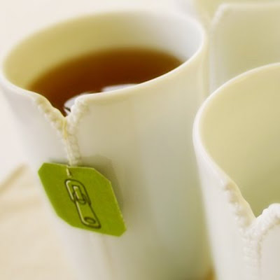 11 creative tea cups curious funny photos pictures for Cool tea cup designs
