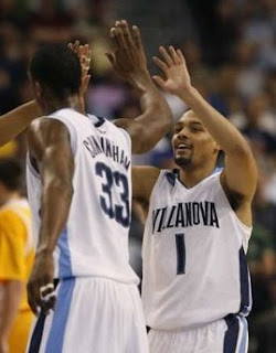 Villanova's Scottie Reynolds is congratulated by teammate Dante Cunningham after scoring against Siena during the first half of their second round game Tampa, Florida 3-23-08 (REUTERS/Scott Audette/US)