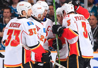 The Calgary Flames are off to a fine playoff start, and the San Jose Sharks can start worrying again. Stephane Yelle scored two goals, Miikka Kiprusoff made 37 saves and the seventh-seeded Flames stunned the NHL's second-best regular season team in their first-round opener, beating the Sharks 3-2 on Wednesday night. (Photo: Don Smith/NHLI via Getty Images)