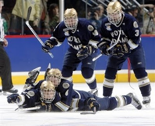 Notre Dame left winger Calle Ridderwall, front bottom, is congratulated after scoring the winning goal by defenseman Dan VeNard, front top, as center Justin White, back left, and defenseman Brett Blatchford skate to the celebration in the overtime period of Notre Dame's 5-4 victory over Michigan in a NCAA semifinal hockey game in Denver on Thursday, April 10, 2008. (AP Photo/David Zalubowski)
