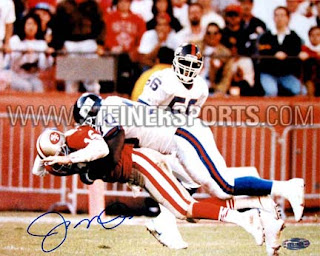 Leonard Marshall Joe Montana 'The Hit' - courtesy of Steiner Sports