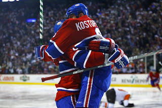 MONTREAL, CANADA- APRIL 24: Tom Kostopoulos #6 of the Montreal Canadiens jumps into the arms of teammate Michael Komisarek #8 after scoring the game winning goal against the Philadelphia Flyers in Game One of the Eastern Conference Semifinals of the 2008 NHL Stanley Cup Playoffs on April 24, 2008 at the Bell Centre in Montreal, Canada. The Montreal Canadiens defeated the Philadelphia Flyers 4-3 in overtime. (Photo by Phillip MacCallum/Getty Images)