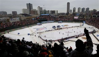 Fans cheer during the first period of the NHL Winter Classic hockey game between the Detroit Red Wings and the Chicago Blackhawks at Wrigley Field, Thursday, Jan. 1, 2009 in Chicago.<br />(AP Photo/M. Spencer Green)