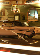 A vintage car sits in front of the Bistro