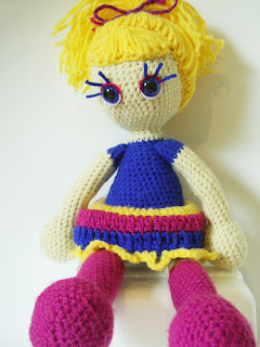 handmade crochet craft art amigurumi doll girl yellow blue purple eyes hair yarn toy