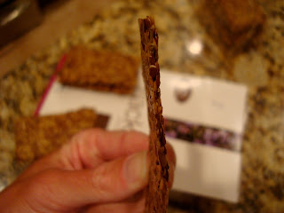 Hand showing the side of one cracker