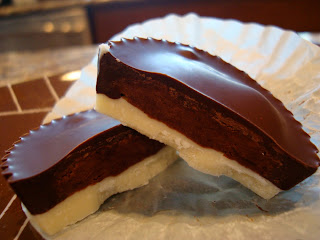Dark and White Chocolate Peanut Butter Cup split in half showing center