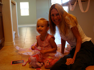 Woman and young girl sitting on floor smiling
