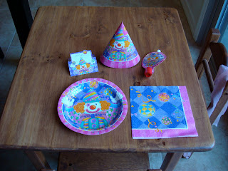 Childs Birthday party table with plate, hat and napkin