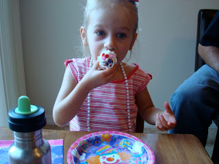 Young girl eating cupcake