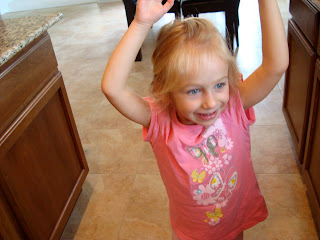 Little girl dancing in kitchen