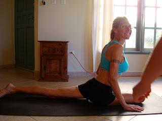 Woman doing Eka Pada Rajakapotasana yoga pose