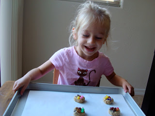 Young girl holding tray of cookies
