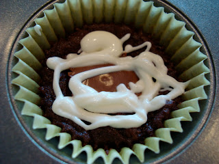 Peanut Butter Cup Brownie Cupcake with white chocolate icing