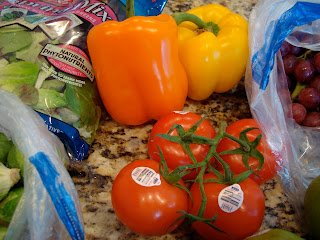 Tomatoes and 1 Orange and 1 Yellow Bell Pepper