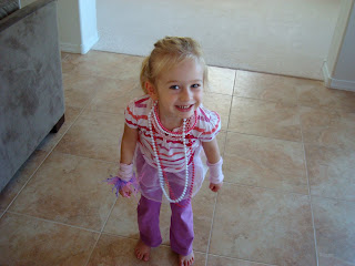 Young girl playing dress up