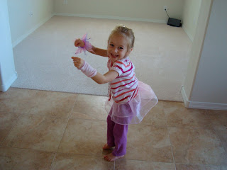 Young girl in dress up clothes dancing