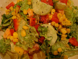Sweet Mango & Lime Corn Salsa on top of green salad