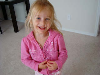 Young girl standing with hands touching smiling