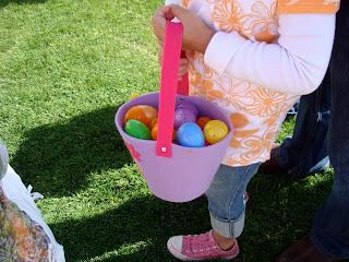 Child holding basket full of Easter eggs
