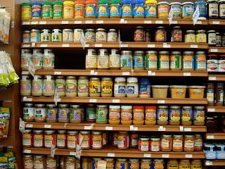 Shelves full of various nut butters