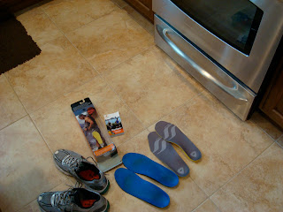 Insoles and shoes on floor