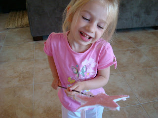 Young girl smiling holding princess wand
