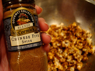 Hand holding jar of Chinese Five Spice