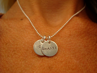 Close up of necklace on womans neck